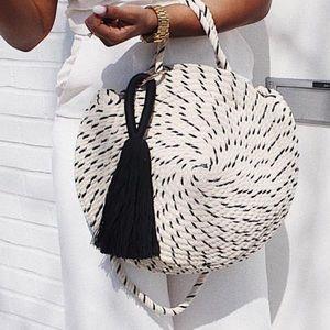 Zara woven rope circle bag with black tassel